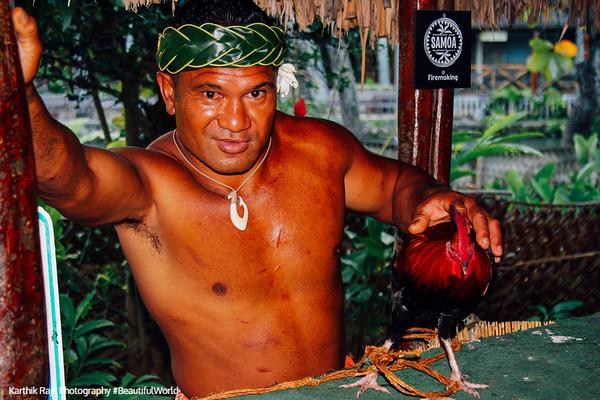 Samoan with his fighter cock, Polynesian village, Oahu, Hawaii, USA