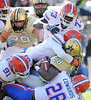 Nov 6, 2010; Nashville, TN, USA; Vanderbilt Commodores running back Kennard Reeves (28) is swarmed by the Florida Gators defense during the second half at Vanderbilt Stadium. The Gators beat the Commodores 55-14. Mandatory credit: Don McPeak-US PRESSWIRE