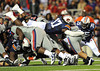 Oct 30, 2010; Oxford, MS, USA; Auburn Tigers linebacker Josh Bynes (17) leaps over the line and stuffs Mississippi Rebels quarterback Jeremiah Masoli (8) on a fourth down and short attempt during the first half at Vaught Hemmingway Stadium. Mandatory credit: Don McPeak-US PRESSWIRE