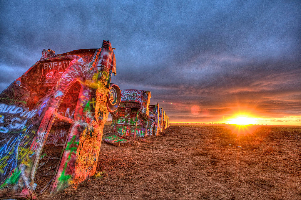 Cadillac Ranch just outside Amarillo, Texas. This was a bitter cold and windy November sunrise. It was so windy, my tripod (with $4500 camera and $1600 lens attached!) blew over right into a Texas cow pie. I wiped the gear off with my hand and kept shooting. You gotta do what you gotta do!<br /> PS: The advantage to bitter cold and windy Texas sunrises is that no one else is out there! BTW, this is also an HDR image (multiple images combined together into one).