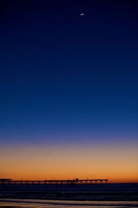Crescent moon over the Ocean Beach Pier.
