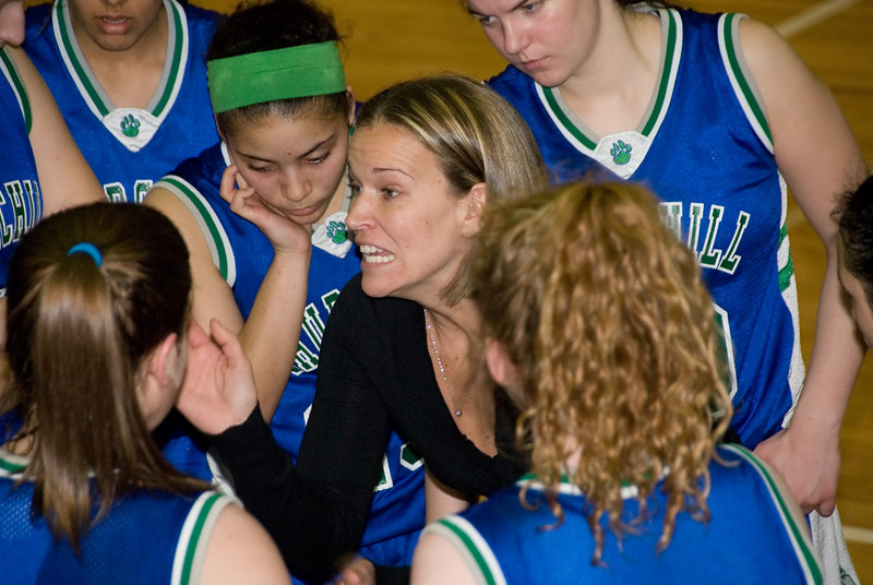 Girls Basketball Churchill vs Whitman --Churchill's intense coach explains to her glum team what needs to be done to climb back into the game.