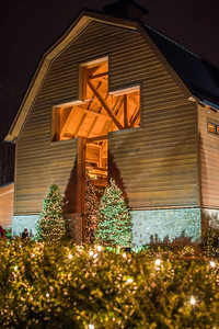 architectural cross at a village decorated for christmas time
