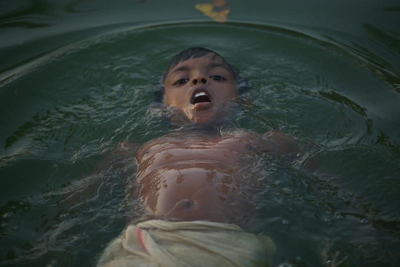 Little boy swimming in the backwaters