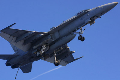 F-18 Hornet on approach, tailhook extended.