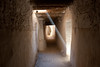 A shaft of light descends from the level where women walk to the level where men reside when they are in town (Ghadames, Libya).