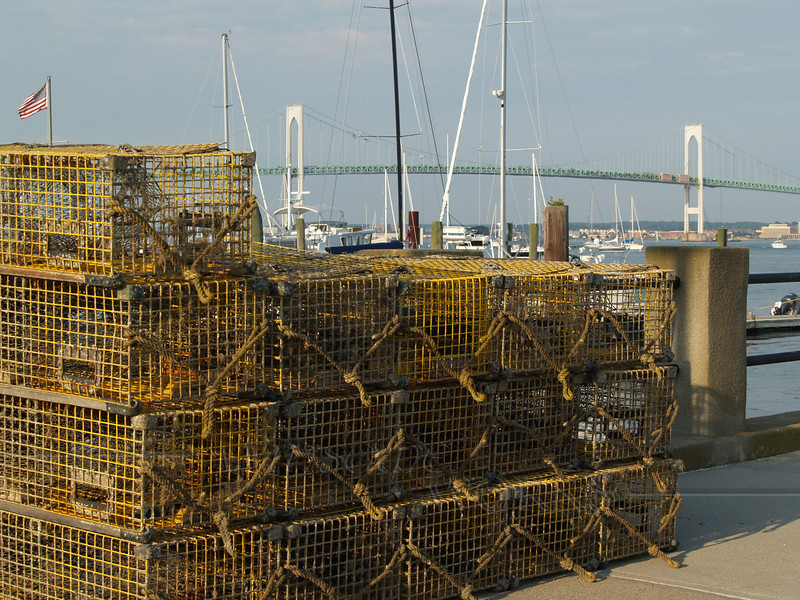 Lobster traps in Jamestown Harbor, with Claiborne Pell Newport Bridge in background