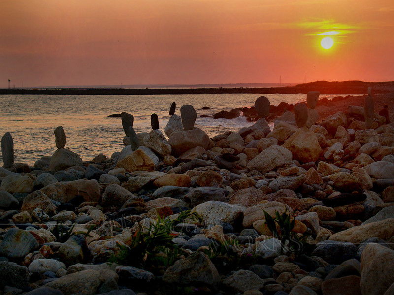 Cairns in sunset at Point Judith Light, RI