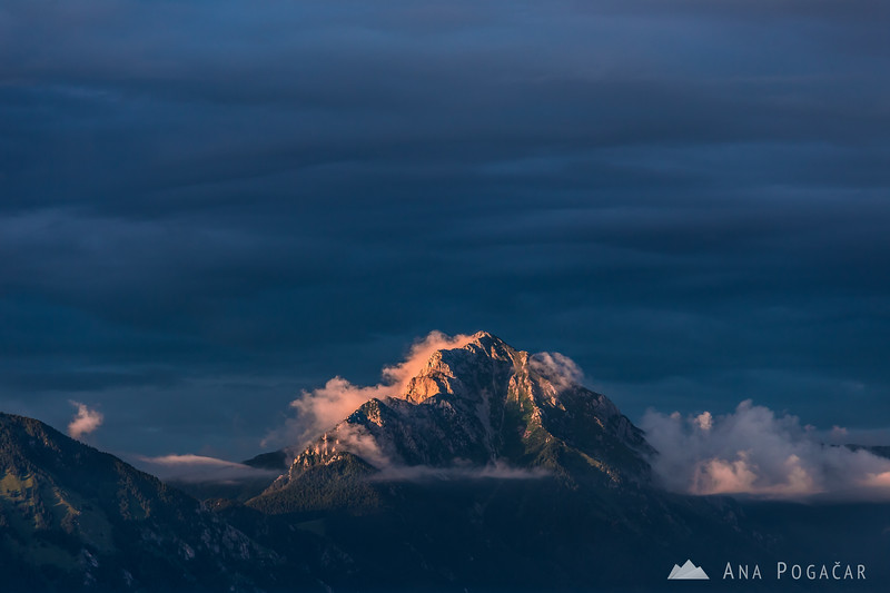 Last sun rays on Mt. Storžič with some ominous clouds in the background, as seen from Jamnik.