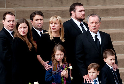 Former Mayor Richard M. Daley stands with his children and grandchildren as Maggie Daley's funeral procession arrives at Old St. Pat's Church, Monday, November 28, 2011. | Jean Lachat~Sun-Times