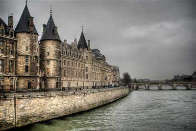 The Conciergerie (French: La Conciergerie) is a former royal palace and prison in Paris, located on the west of the Île de la Cité, near the Cathedral of Notre-Dame. It is part of the larger complex known as the Palais de Justice, which is still used for judicial purposes. Hundreds of prisoners during the French Revolution, including Marie Antoinette, were imprisoned and executed on the guillotines at La Conciergerie.