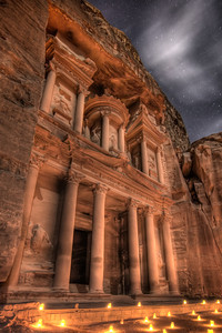 """At the end of the narrow gorge stands Petra's most elaborate ruin, Al Khazneh (popularly known as """"the Treasury""""), hewn into the sandstone cliff."""