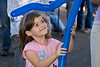 """Reopening of Concord Park -- 4 year old Amanda Kahlenberg is delighted with the """"octopus""""."""