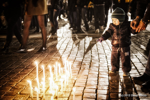 Little boy is attracted to candles