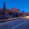 Headlights through Red Canyon Arch