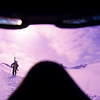 A shot of a skier walking up a ridge with his skis on his backpack taken through a pair of googles, Whistler's backcountry, Whistler, BC, Canada.