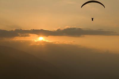 Paragliders flying at sunset in Merida, Venezuela.