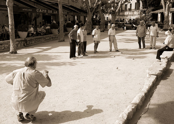 I took this in St. Paul de Vence (or was it Vence?).  It is a shot of some locals playing petanque, similar to Bocce in Italy.  It looks like a nice way to wile away an afternoon in retirement, n'est ce pas?