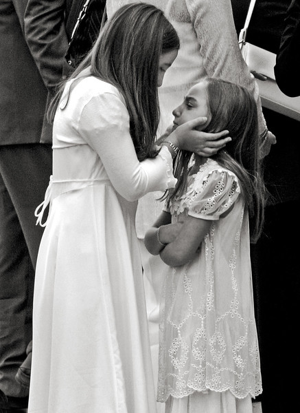 Sister consoling, Italy