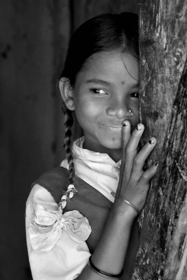 Shy village girl. <br /> Villages in rural India in the state of Maharashtra.