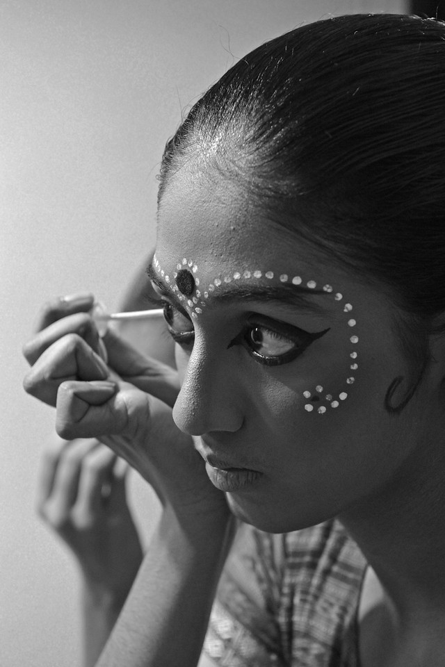 """Odissi dancers of  Sutra Dance Academy, Malaysia getting ready for their performance.<br /> <br /> The Konark Dance & Music Festival held from February, 19th to 23rd, 2010 was organized by Konark Natya Mandap.<br /> <br /> The objectives of the Konark Natya Mandap are to preserve, promote, and project the rich cultural heritage of Orissa and to infuse cultural awareness in the minds of all. Started with painstaking efforts of Guru Gangadhar Pradhan, an internationally renowned Odissi dance teacher. 2010 was the silver jubilee year of the festival. For more details see  <a href=""""http://www.konarknatyamandap.org/"""">http://www.konarknatyamandap.org/</a> <br /> <br /> <br /> The festival takes place in an open-air auditorium and enlivens the spirit of the sculptures of Konark temple which is just a short distance away. The festival brings in the spirit of merry to all the onlookers. The music reverberates and combined with the sounds of the ankle bells of the dancers enthralls the audiences. The elegant steps and expressions of the dancers makes the event so captivating that no one can ever forget it."""