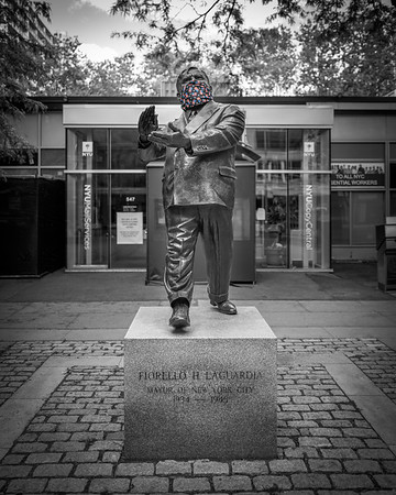 Statue of former New York City Mayor Fiorello La Guardia wearing a mask reflective of today's society during the  global COVID-19 pandemic.