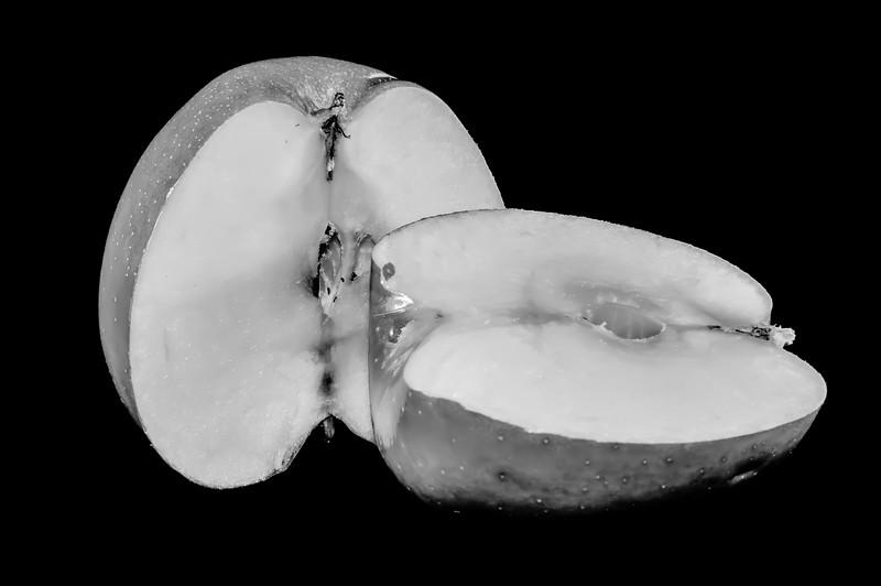 sliced apples on black background
