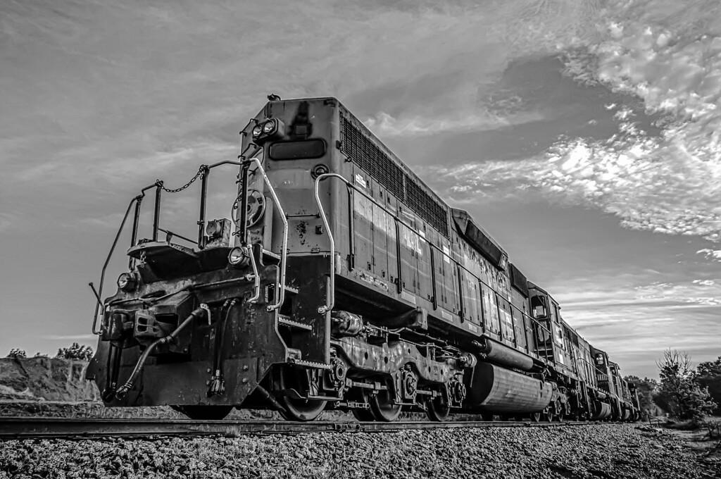 blue freight train engine at sunrise