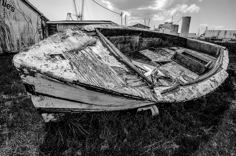 old rotten abandoned row boat on land
