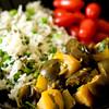 Kashmiri baingan (eggplant-apple curry) served with peas pulao and cherry tomatoes