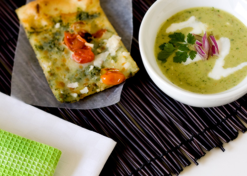 Chilled avocado soup, served with pesto flatbread