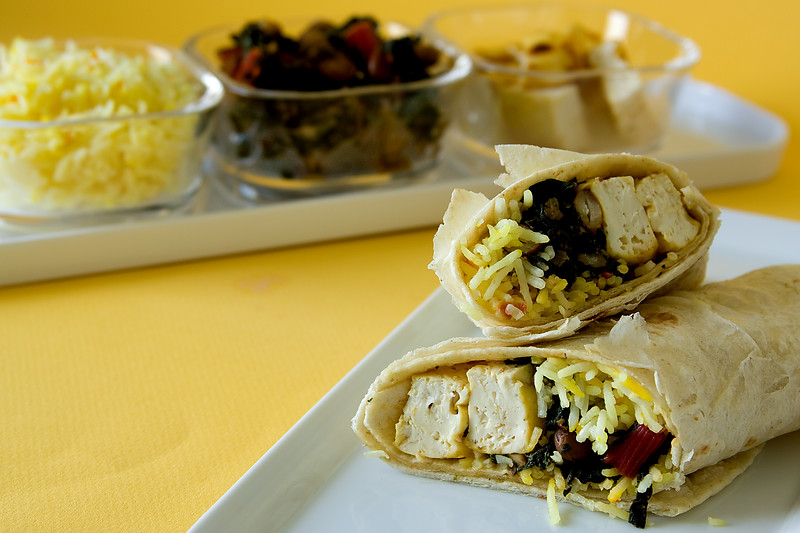 Coconut tofu wraps - Vegan wraps with coconut flavored tofu, sauteed swiss chard and saffron basmati rice
