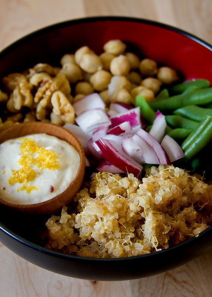 Salad with sprouted quinoa, millet, chickpeas, green beans, red onions, walnuts and lemon-tahini dressing