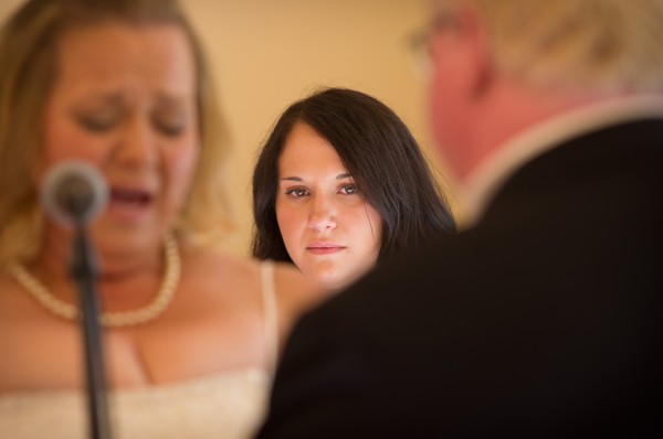 daughter of the bride listens to vows groom tears up as bride during  a fall wedding at the Clock Tower in Rockford, IL