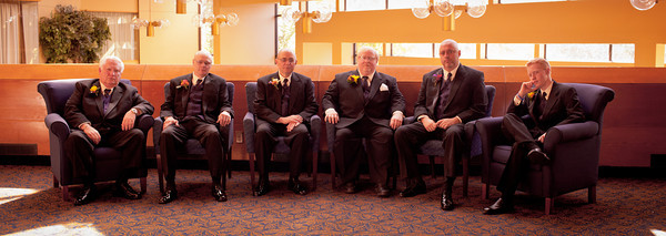 Groomsmen pose for a portrait at  a  fall wedding at the Clock Tower in Rockford, IL
