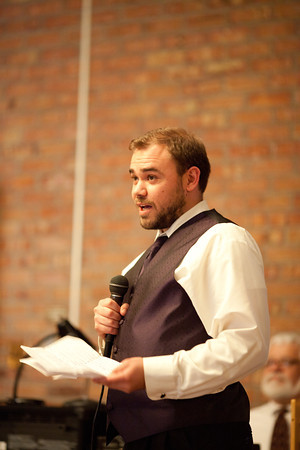 son of bride gives a speech during a fall wedding at the Clock Tower in Rockford, iL