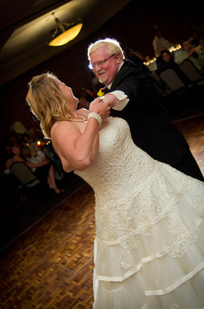 bride and groom's first dance after their autumn wedding at the Clock Tower in Rockford, IL