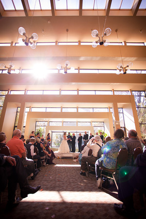 sunlight cascades through windows during  a fall wedding at the Clock Tower in Rockford, IL