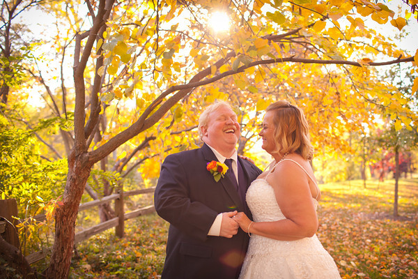 bride and groom in the romatic gorgeous fall colors following their autmn wedding  at the Clock Tower in Rockford, IL