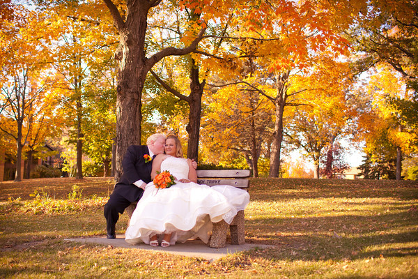 bride and groom in the romatic gorgeous fall colors following their autumn wedding  at the Clock Tower in Rockford, IL