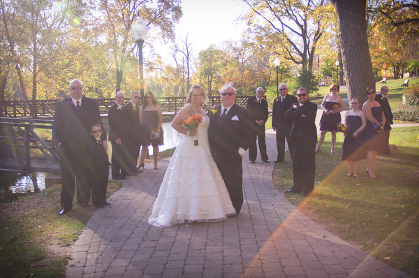 bridal party at park outdoor following an autumn wedding at the Clock Tower in Rockford, IL