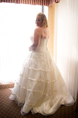 elegant bride in bridal suite before her fall wedding at the Clock Tower in Rockford, IL