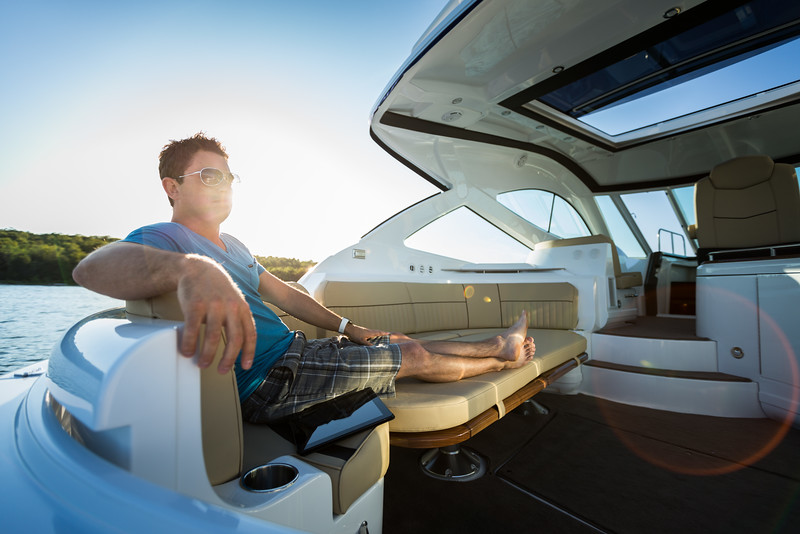 Man enjoying the sun in large boat cockpit.