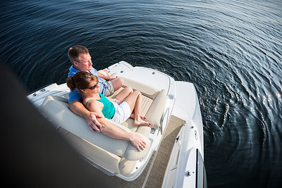 Couple enjoying rear-facing boat seating.