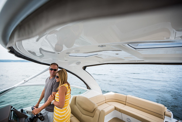Couple at the helm enjoying a yacht.