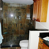 New.. Cut wall down to feel more spacious, beautiful new cabinets and counters.  Note.. Georgous all tile shower with frameless glass.