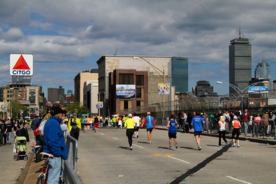 Late afternoon of runners crossing the mile 25 marker of the 114th Boston Marathon.  See this picture move...view time-lapse >  http://vimeo.com/11165649