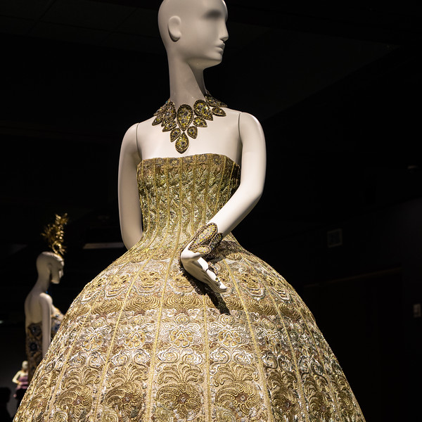 Gown embroidered with wire and silk, 24-karat gold and silver-spun thread and embellished with Swarovski sequin accessories