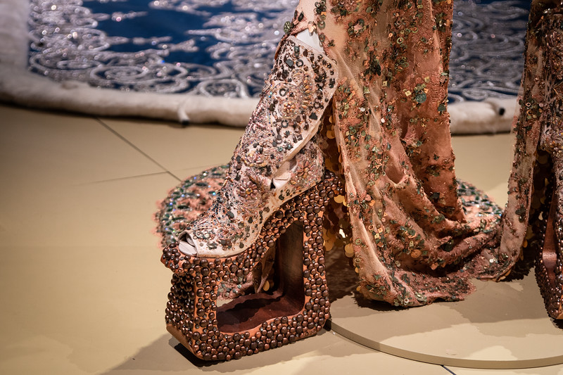 Detailed view of shoes that accompany the lace jumpsuit