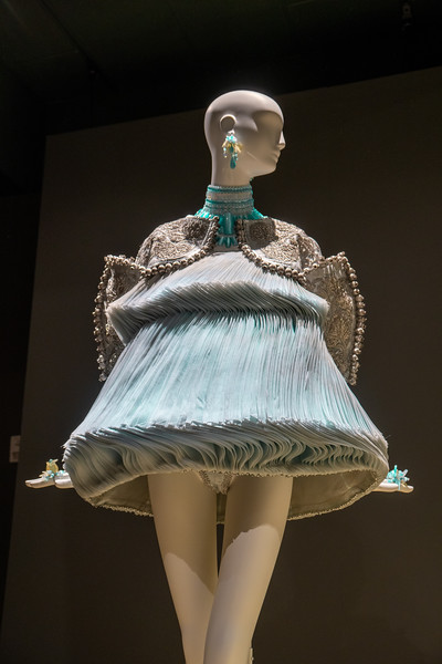 Pleated silk dress ornamented with beads, and embroidered silk jacket with silk-covered bead fringe